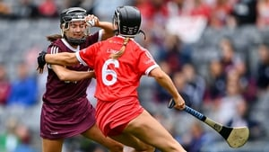 Aoife Donohue battles for possession with Laura Treacy