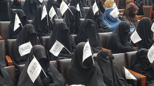 Women students show their support for the Taliban at a Kabul university