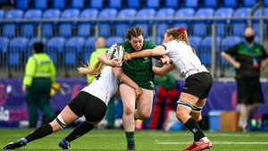 Meadbh Scally of Connacht is tackled by Lauren Maginnes, right, and Taryn Schutzler of Ulster during Saturday's clash