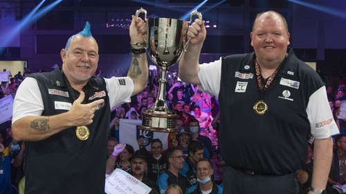 Peter Wright and John Henderson celebrate their victory. Credit: Kais Bodensieck/PDC Europe