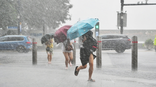 The storm was downgraded over the weekend, but Shanghai officials maintained an orange typhoon alert for today