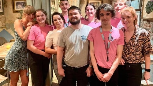Taylor Swift (left) with the staff of the Tipsy Bird in Belfast