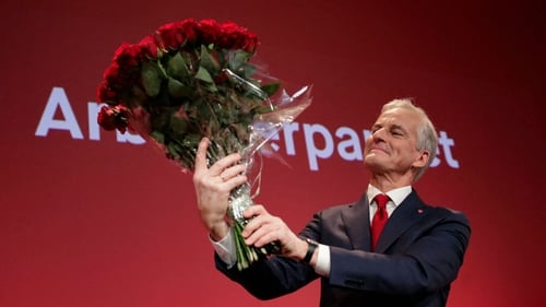 Jonas Gahr Støre holds a bouquet of red roses after the results of the Labour Party's election event in Oslo