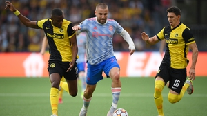Luke Shaw of Manchester United is challenged by Christopher Martins Pereira and Christian Fassnacht of Young Boys