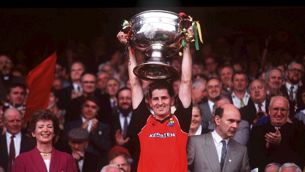 Down captain Paddy O'Rourke raises the Sam Maguire aloft after their 1991 final win over Meath