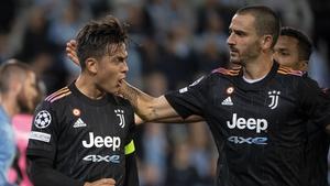 Paulo Dybala and Leonardo Bonucci celebrate Juve's second goal tonight