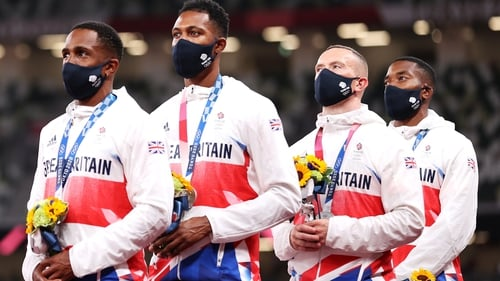 CJ Ujah (l), and his Team GB team-mates stand on the podium during the medal ceremony at the recent Tokyo Games