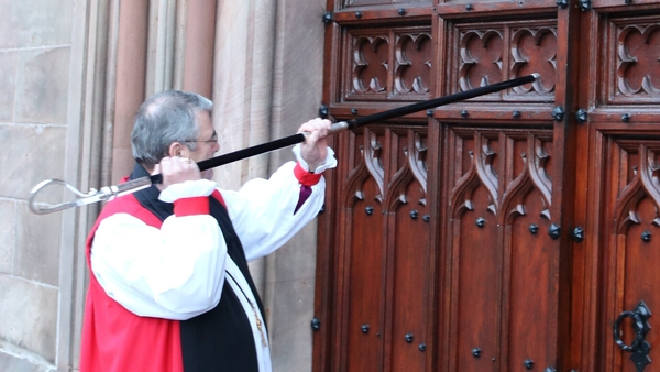 Archbishop John McDowell knocks on the door of St Patrick's Cathedral, Armagh, with his crozier before the Service of Enthronement