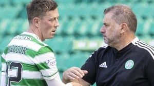Ange Postecoglou will be without captain Callum McGregor (left) on Thursday