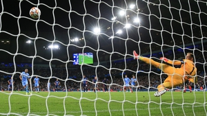 Riyad Mahrez scores Manchester City's third goal from the penalty spot