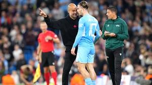 Pep Guardiola gives Jack Grealish some instructions