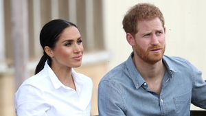 """Prince Harry and Meghan Markle say they are """"humbled"""" to have graced the cover of Time magazine."""
