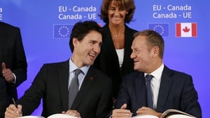 Canadian Prime Minister Justin Trudeau talks with President Donald Tusk at the signing ceremony of CETA in 2016