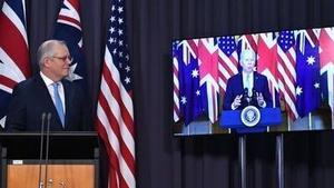 Australian Prime Minister Scott Morrison with US President Joe Biden on video link