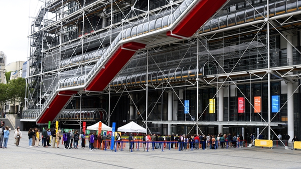 Visitors queue to have their Covid-19 health passes checked before entering the George Pompidou Centre in Paris