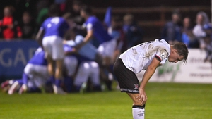 A despondent Daniel Cleary as Harps celebrate the late, late equaliser