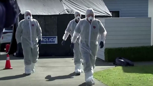 Forensic investigators at the scene of the family home in Timaru, New Zealand