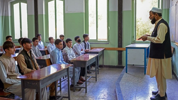 Boys attend their class at a school in Kabul today