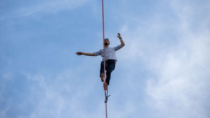 Nathan Paulin traverses a slackline between the Eiffel Tower and Trocadero Square yesterday