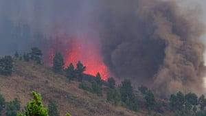 Mount Cumbre Vieja erupts spewing a column of smoke, ash and lava