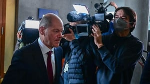 Olaf Scholz pictured as he left the committee meeting