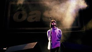 Liam Gallagher on stage at Knebworth in 1996. Roberta Parkin/Redferns