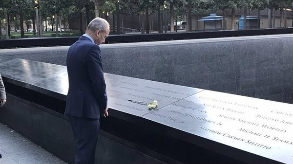 The Taoiseach laid a white rose at each of the names of the six Irish-born victims