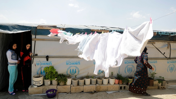Two young Syrian girls at their family's tent in a refugee camp in Tebrol (file image)