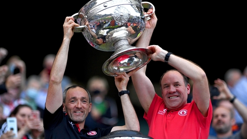 Brian Dooher (L) and Feargal Logan lift the Sam Maguire Cup after Tyrone beat Mayo