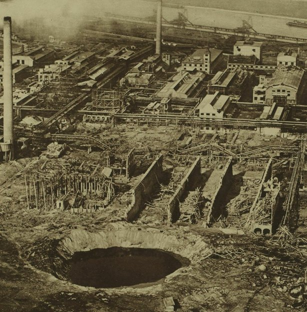 Century Ireland 214 - The crater caused by the explosion and the ruins of the Oppau facility from the air Photo: Illustrated London News, 8 October 1921