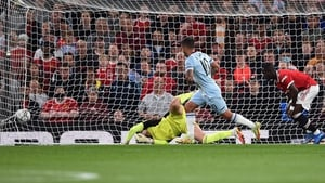 Manuel Lanzini beats Dean Henderson in front of the Stretford End
