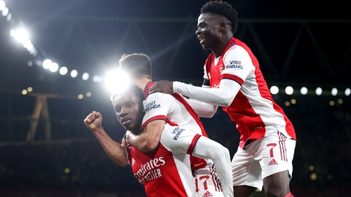 Eddie Nketiah celebrates with Arsenal team-mates Cedric Soares and Bukayo Saka
