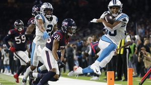 Chuba Hubbard (30) of the Carolina Panthers gets pushed out of bounds by Vernon Hargreaves III (26) of the Houston Texans