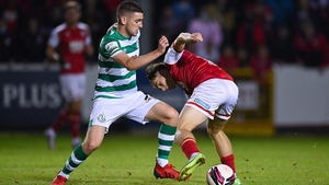Dylan Watts of Shamrock Rovers in action against Matty Smith