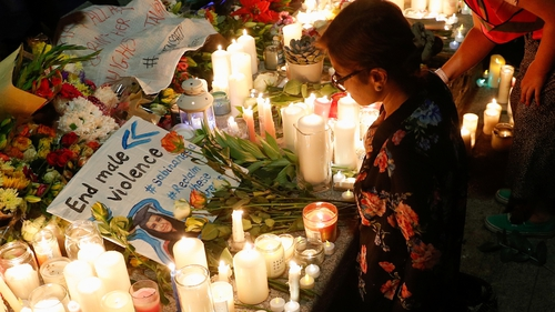 Flowers and candles were laid during a vigil in memory of Sabina Nessa