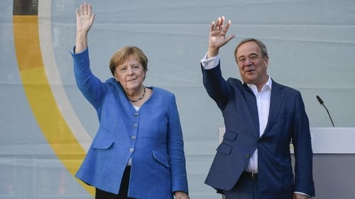 Angela Merkel and Armin Laschet pictured in Aachen, western Germany, today