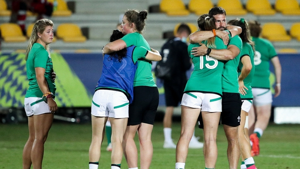 Ireland players comfort each other after the defeat to Scotland