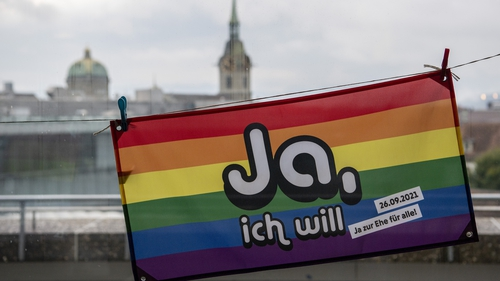 A rainbow flag reading 'Yes, I will' pictured in Bern, Switzerland, today