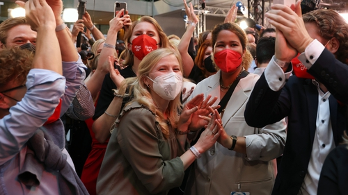 Members of the German Social Democrats (SPD) celebrate initial results at SPD headquarters in Berlin