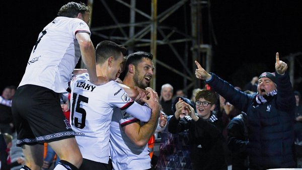 Patrick Hoban celebrates with fans and teammates after scoring his side's second goal
