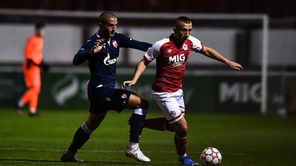 Sam Curtis of St Patrick's Athletic in action against Aleksander Kahvic of Crvena Zvezda