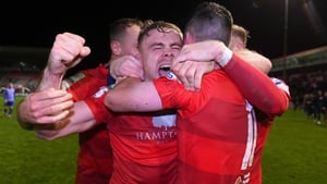 Georgie Poynton celebrating with teammates after Shelbourne seal promotion