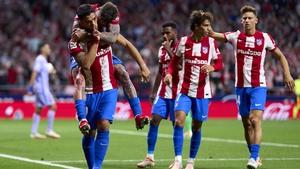 Luis Suarez celebrates scoring against his former team