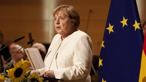 Angela Merkel was speaking at celebrations in the eastern city of Halle to commemorate German reunification in 1990