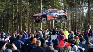 Spectators watch as the Hyundai of Irish driver Craig Breen and his Irish co-driver Paul Nagle soar through the air in Finland
