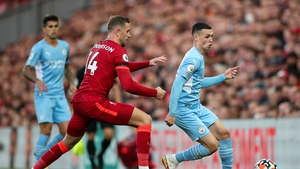 Phil Foden in action against Jordan Henderson at Anfield