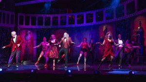 Kristian Lavercombe (centre) leads the charge as the Rocky Horror crew do the Time Warp