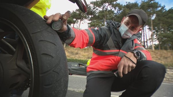A member of the RSA carries out a tyre check demonstration at Chapelizod in Dublin