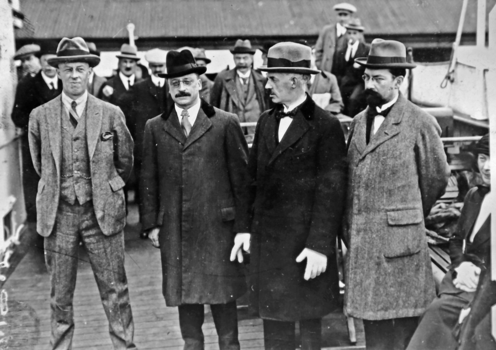 Image - Four of the delegates before setting off from Kingstown/Dún Laoghaire: Bardon, Griffith, Duggan and Duffy. Collins took great care NOT to be included in these group photographs, to the puzzlement of the Press. (Credit: Getty Images)