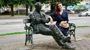 Annemarie Ní Churreáín with the statue of Patrick Kavanagh by Dublin's Grand Canal (Pic: Enda Rowan)